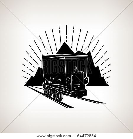 Silhouette coal mine trolley against mountains and sunburst,mining industry, coal mining