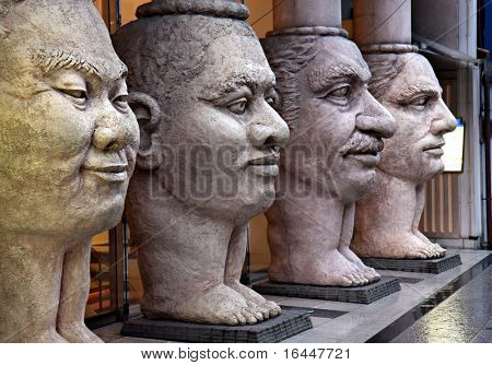 Scupture of 4 faces representing people from Africa, Arabia, the Orient, and the West - Osaka Japan