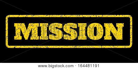 Yellow rubber seal stamp with Mission text. Vector message inside rounded rectangular banner. Grunge design and unclean texture for watermark labels. Horisontal sticker on a blue background.