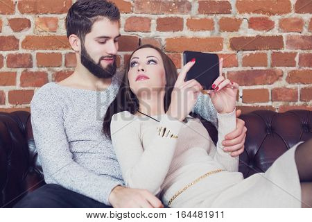 Young couple reading tablet and share opinion with each other or online shopping