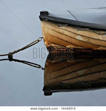 Old rowboat moored in a peacuful bay - Strahan, Tasmania