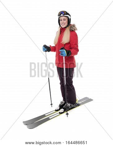 Attractive girl skier on white background. Sportswoman in a red jacket in a ski suit. Portrait in full growth.