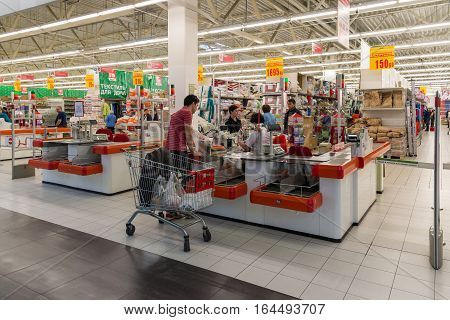 Moscow Russia - October 01.2016. People about cash buyers in the store Auchan in shopping center Gagarin