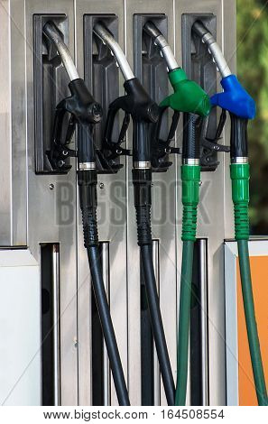 Four refueling nozzles on gas station. Close-up view