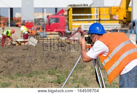 Surveyor Engineer At Construction Site
