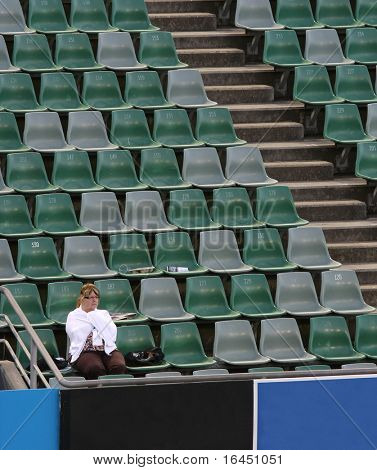 MELBOURNE, AUSTRALIA - JANUARY 27: A single fan in Margaret Court Arena at the 2010 Australian Open on January 27, 2010 in Melbourne, Australia