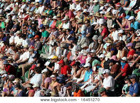 MELBOURNE - JANUARY 27: Crowd watch Roger Federer tennis game at the 2010 Australian Open at Rod Laver Arena on January 27, 2010 in Melbourne