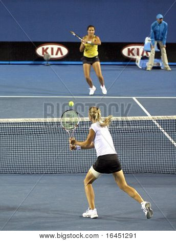 MELBOURNE, AUSTRALIA - JANUARY 27: Maria Kirilenko (Front) in action in a doubles match at the 2010 Australian Open on January 27, 2010 in Melbourne, Australia
