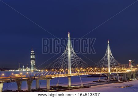 Saint-Petersburg Russia - January 3 2017: Night view of the headquarters of Gazprom through the pylons of the cable-stayed bridge of the Western High Speed Diameter in St. Petersburg.