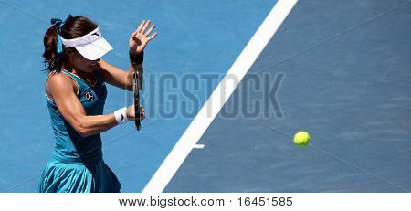 MELBOURNE, AUSTRALIA - JANUARY 26: Jie Zheng in action at her quarter final win over Maria Kirilenko during the 2010 Australian Open on January 26, 2010 in Melbourne, Australia