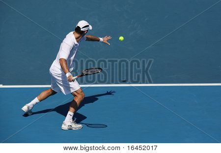 MELBOURNE - MARCH 6: Paul Hanley of Australia hits a forehand in the doubles rubber of the Davis Cup tie against Chinese Taipei on March 6, 2010 in Melbourne