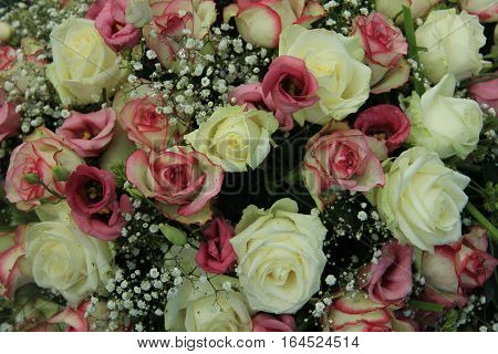 Pink and white roses in a mixed bridal bouquet