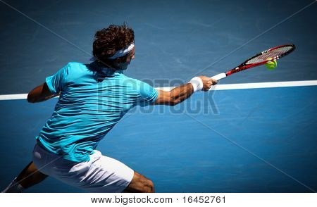 MELBOURNE, AUSTRALIA - JANUARY 27: Roger Federer in action at his win over Nikolay Davydenko during a quarter final match in the 2010 Australian Open on January 27, 2010 in Melbourne, Australia