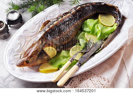 Sturgeon baked with vegetables. Healthy food. Russian traditions.