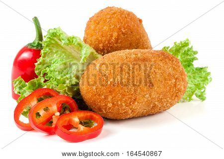 two fried breaded cutlet with lettuce and pepper isolated on white background.