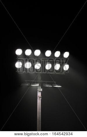 Stadium lights at night in black bacground