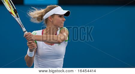 MELBOURNE - JANUARY 25:  Maria Kirilenko of Russia in a mixed doubles match at the 2011 Australian Open on January 25, 2011 in Melbourne, Australia.