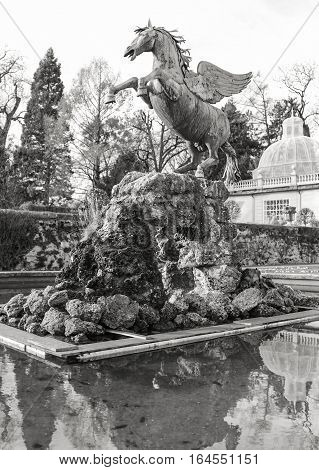 The Mirabell gardens Pegasus statue stands center stage, since 1913, on the rocks in a fountain in Salzburg, Austria