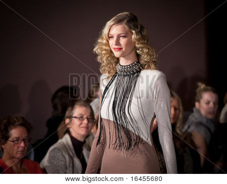 MELBOURNE, AUSTRALIA - MARCH 19: A model showcases designs by Lisa Taranto in the 2011 L'Oreal Melbourne Fashion Festival at Central Pier, Docklands on March 17, 2011 in Melbourne, Australia