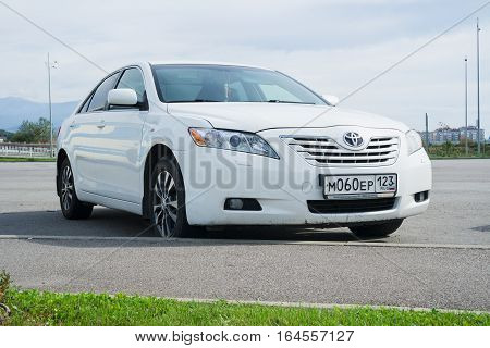 Sochi, Russia - October 11, 2016: White Toyota Camry parked on the street.