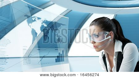 Sexy latina brunette in future glasses and headset. Looking at the transparent screen with interface. Pretty young business people in interiors / interfaces series.