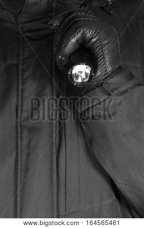 Gloved Hand Holding Tactical Flashlight, Bright Light Emiting Brightly Lit, Serrated Strike Bezel, Black Grain Leather Glove And Cop Jacket, Large Detailed Vertical Closeup, Patrolling Police Security Guard Staff Policeman, Covert Operations Patrol Forens