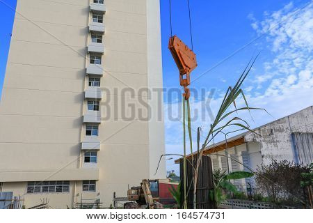 Crane Hook yellow in construction site .