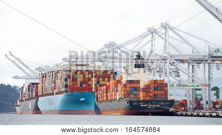 Oakland CA - January 02 2017: The Port of Oakland loads and discharges more then 99 percent of containerized goods moving through Northern California the nations fourth largest metropolitan area.