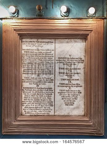 The Ten Commandments or the Aseret ha-Dibrot are framed on the wall of a synagogue in Mumbai India.