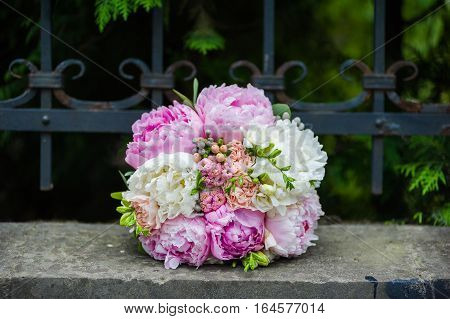 Big wedding bouquet before ceremony. Morning bride