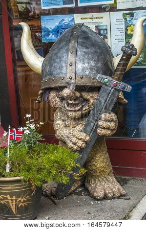 Norway village Geiranger . Figure of troll at the entrance to the museum fjords .