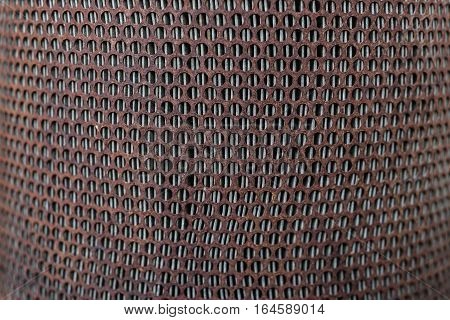 Texture of old rusty metal grid background with holes