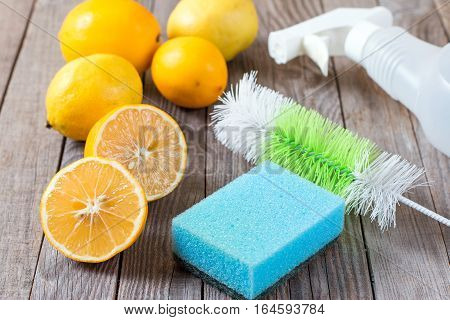 Eco-friendly natural cleaners baking soda lemon and cloth on wooden table