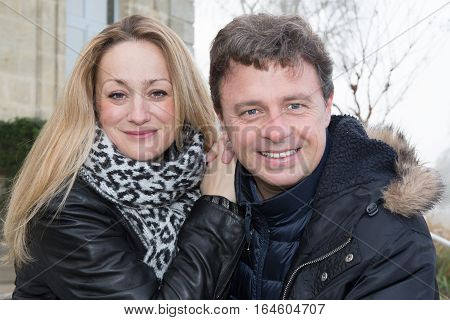 A 40 Year Old Couple Cute And Smiling In Winter