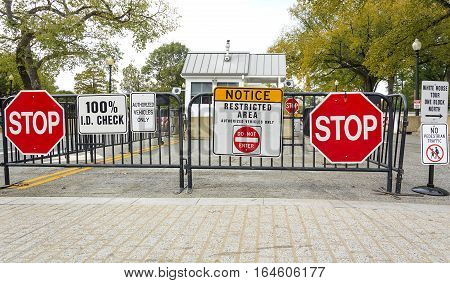 Washington DC USA october 30 2016: A road block stop sign at the entrance of the White House in Washington DC.