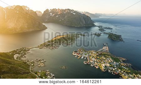 Reinebrinen, Norway - June 1, 2016: Beautiful norwegian landscape with famous top peak Reinbringen, Lofoten Islands and view on famous fishing village Reine, Moskenesoya and norwegian sea