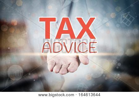 Man Hand Holding Tax Advice Text On Blurry Home Icon Property Background.