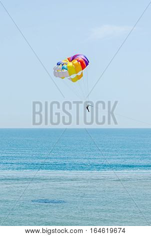 Colored Parasail Wing In The Blue Sky, Parasailing Also Known As Parascending Or Parakiting