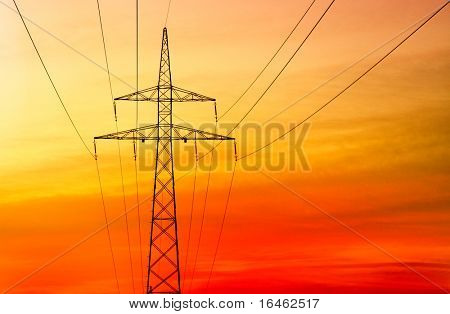 Electricity pylon at orange sunset