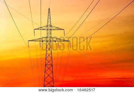 Electricity pylon at orange sunset