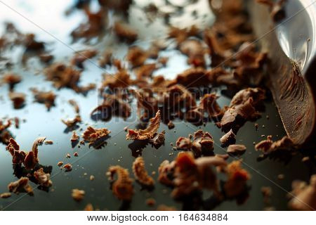 grated chocolate on the black glossy surface