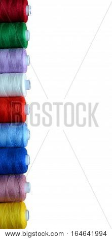 Multicolor sewing threads isolated on white - concept of sewing, diversity, rainbow