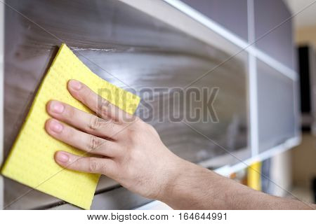 Cleaning Furniture In The Kitchen