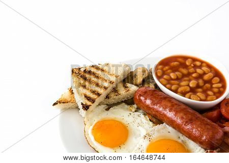 Traditional full English breakfast with fried eggs, sausages, beans, mushrooms, grilled tomatoes and bacon isolated