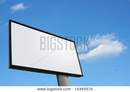 Big white advertising wall on blue sky