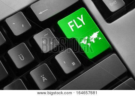 grey keyboard green enter button fly world