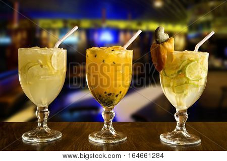 Cashew, Lemon And Passion Fruit Caipirinha Of Brazil On Wooden Background