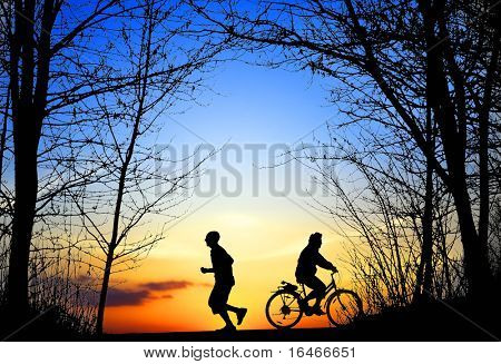 Recreation, jogging and cycling at sunset