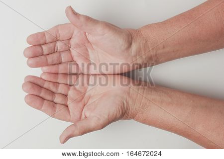 Wrinkled on old woman hand skin, healthy and beauty concept