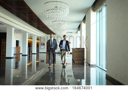 Business people walking in the office corridor